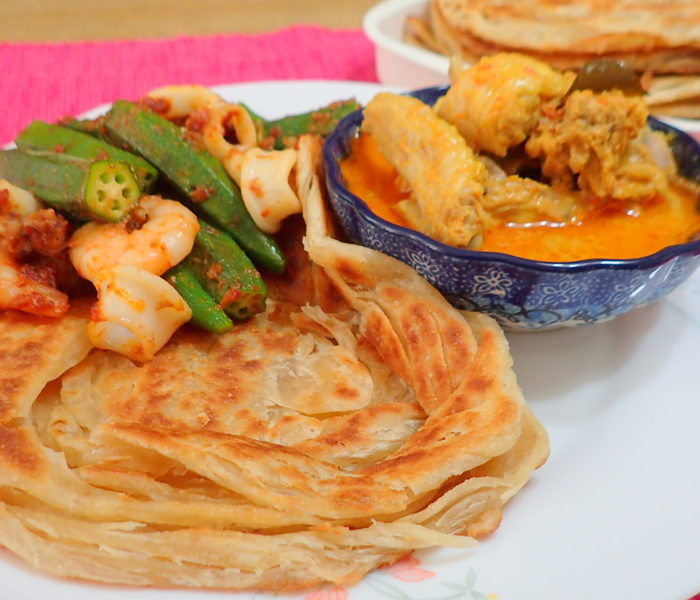 Roti Canai with chicken curry.