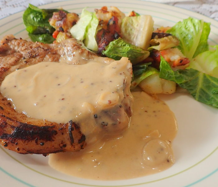 Pork Chops in a white wine creamy mustard sauce