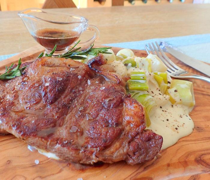 White wine creamy cheesy leeks with pan seared beef steak
